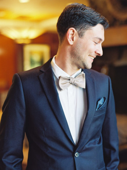 dapper groom portrait on weddin day